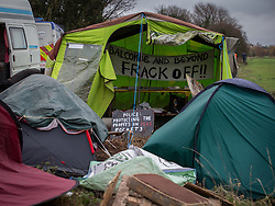© Licensed to London News Pictures . 27/11/2013 . Manchester , UK . Tents pitched alongside the access road to the site . Energy firm IGas have today (Wednesday 27th November 2013) been receiving drilling equipment in readiness for exploratory drilling at the site . Anti fracking protesters have established a camp at Barton Moss in Greater Manchester alongside an access road leading to an IGas drilling site .  Photo credit : Joel Goodman/LNP