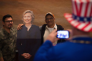 Guests take a photo with a cardboard cutout of Hilary Clinton during the Dallas County Democratic watch party in Dallas, Texas on November 8, 2016. (Cooper Neill for The Texas Tribune)