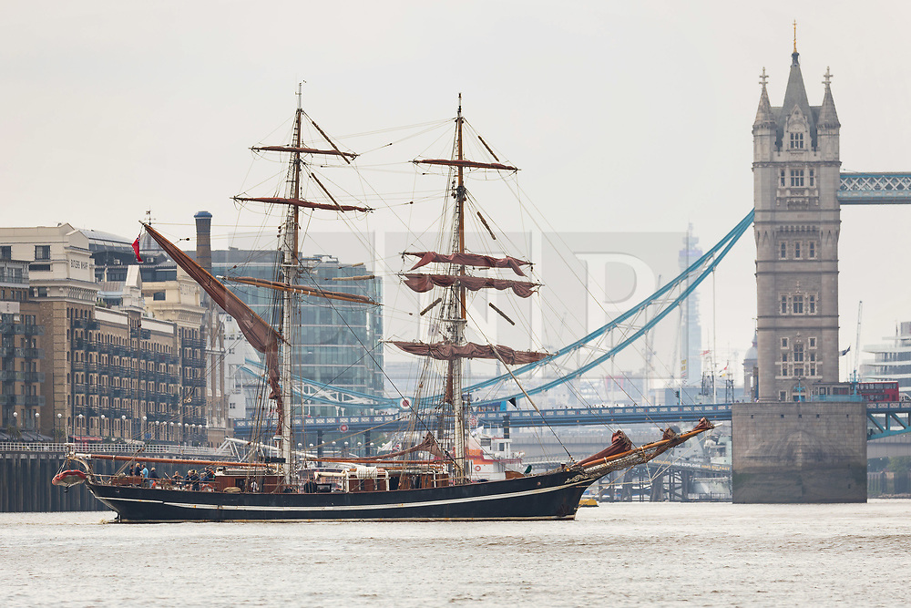 "© Licensed to London News Pictures. 23/05/2018. London, UK. The 107 year old tall ship, ""Eye of the Wind"" sails on the River Thames in front of Tower Bridge during a London visit to join celebrations to mark forty years since the start of Operation Drake - a two year round the world expedition, of which Eye Of The Wind was the flagship. One of the last traditional sailing ships left, Eye of the Wind was originally built in Germany in 1911 as a Schooner but was given a new lease of life in 1973 when she was bought by Anthony ""Tiger"" Timbs, an Englishman from greater London. A group of enthusiastic ship lovers began to rig the vessel as a brigantine and her full restoration at a shipard in Faversham, Kent took nearly four years to complete. Photo credit: Vickie Flores/LNP"