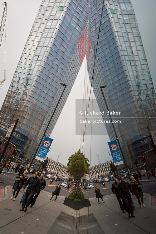 The symmetrical reflection of the One Blackfriars residential tower, on 17th October 2017, in Southwark, London, England. 1 Blackfriars or One Blackfriars, is a mixed-use development at the junction of Blackfriars Road and Stamford Street at Bankside, London. The development is a 52-storey 170m tower and two smaller buildings of 6 and 4 stories respectively. Uses include residential flats, a hotel and retail.