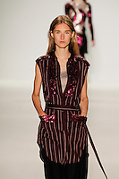 A model walks the runway wearing Richard Chai Love Spring 2015 during Mecedes-Benz Fashion Week in New York on September 4th, 2014