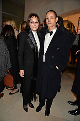 LADY VICTORIA GETTY and her son at a private view of Isabella Blow: Fashion Galore! held at Somerset House, London on 19th November 2013.