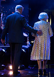 Queen Elizabeth II and the Prince of Wales leave the stage at the Royal Albert Hall in London following a star-studded concert to celebrate her 92nd birthday.