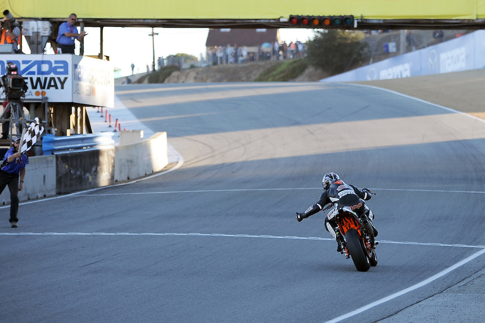 Steve Rapp crosses the finish line to win the race, and the national title, of the 2013 AMA Harley Davidson XR1200 race at Mazda Raceway Laguna Seca.