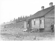 """John Barriger, on official RFC inspection tour, has stopped to look around the RGS Lizard Head facilities with other members of the inspection team.  This shows the not-often photographed rear side of the section house.<br /> RGS  Lizard Head, CO  9/24/1935<br /> In book """"Rio Grande Southern, The: An Ultimate Pictorial Study"""" page 142<br /> Also in """"RGS Story Vol. IV"""", p. 282."""