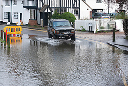 ©Licensed to London News Pictures 21/12/2019. <br /> Eynsford ,UK. Motorists risk driving through flood water. The River Darent in Eynsford, Kent has burst its banks overnight due to the continued heavy rain. The Riverside road is closed at one end near the ford bridge. Photo credit: Grant Falvey/LNP