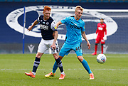 Derby County's Louie Sibley holds of Ryan Woods of Millwall during EFL Sky Bet Championship between Millwall and Derby County at The Den Stadium, Saturday, June 20, 2020, in London, United Kingdom. (ESPA-Images/Image of Sport)