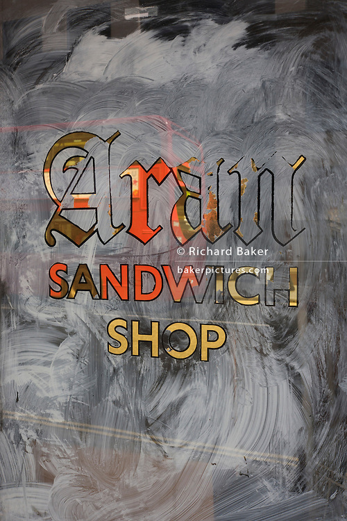 White emulsion paint has been smeared over a sandwich shop, a victim of the UK recession.