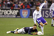 10 February 2006: Clint Dempsey (l), of the United States, is fouled by Japan's Shinji Ono (18). The United States Men's National Team defeated Japan 3-2 at SBC Park in San Francisco, California in an International Friendly soccer match.
