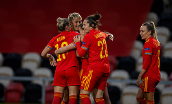 NEWPORT, WALES - Thursday, October 22, 2020: Wales' Lily Woodham (2nd from R) celebrates after scoring the fourth goal with team-mates during the UEFA Women's Euro 2022 England Qualifying Round Group C match between Wales Women and Faroe Islands Women at Rodney Parade. Wales won 4-0. (Pic by David Rawcliffe/Propaganda)