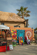 Market stall by beach with palm tree in background, Cadiz, Andalusia, Spain