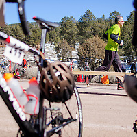Douglas Deming jogs into the bicycle transition at the end of the final running leg of the Mount Taylor Quadrathlon in Grants Saturday.