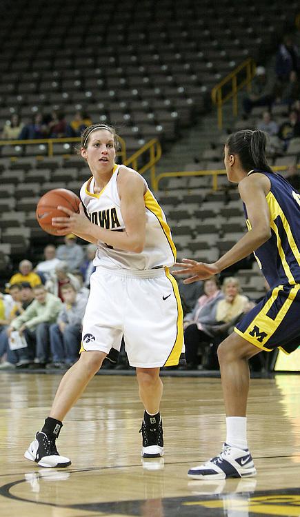 08 February 2007: Iowa forward Wendy Ausdemore (32) drives to the basket in Iowa's 66-49 win over Michigan at Carver-Hawkeye Arena in Iowa City, Iowa on February 8, 2007.