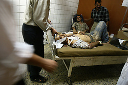 Haider Shaker, 30, is transfered out of the Al Kindy Hospital after he suffered serious injuries to the neck and the loss of his left ear while working at the UN base inside the Canal Hotel, where a cement truck packed with explosives detonated outside the offices killing 20 people and devastating the facility in Baghdad, Iraq on Aug. 19, 2003. This was an unprecedented suicide attack against the world body with at least 100 people wounded.