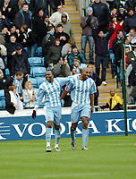 Photo: Kevin Poolman.<br />Coventry City v Burnley. Coca Cola Championship. 25/02/2006. <br />Coventry's Stern John (L) and Dele Adebola celebrate their goal.