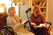 Minister age 36 counseling elder age 87 with bible.  WesternSprings Illinois USA