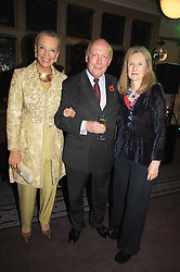 Left to right, HRH PRINCESS MICHAEL OF KENT, JULIAN FELLOWES and LADY CAROLINE PERCY at a party to celebrate the publication of 'Past Imperfect' by Julian Fellowes held at Cadogan Hall, 5 Sloane Terrace, London SW1 on 4th November 2008.