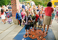 A combination of excitement and jitters as 1st and 2nd graders line up at Elm Street School for their first day Tuesday morning.  (Karen Bobotas/for the Laconia Daily Sun)