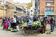Early morning vegetable market on the streets of Patan, Nepal.