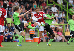 Forest Green Rovers Yan Klukowski and Alhassan Bangura tackle Liam Kelly of Bristol City - Photo mandatory by-line: Dan Rowley/JMP  - Tel: Mobile:07966 386802 20/07/2013 -Forest Green Rovers  vs Bristol City  - SPORT - FOOTBALL - Forest Green Rovers - Bristol city  -