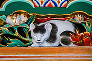 "The Sleeping Cat Carving (Nemurineko) protects the entrance gate to the grave of Lord Tokugawa Ieyasu. Toshogu Shrine is the final resting place of Tokugawa Ieyasu, the founder of the Tokugawa Shogunate that ruled Japan for over 250 years until 1868. Ieyasu is enshrined at Toshogu as the deity Tosho Daigongen, ""Great Deity of the East Shining Light"". Initially a relatively simple mausoleum, Toshogu was enlarged into the spectacular complex seen today by Ieyasu's grandson Iemitsu during the first half of the 1600s. The lavishly decorated shrine complex consists of more than a dozen buildings set in a beautiful forest. Countless wood carvings and large amounts of gold leaf were used to decorate the buildings in a way not seen elsewhere in Japan. Toshogu contains both Shinto and Buddhist elements, as was common until the Meiji Period when Shinto was deliberately separated from Buddhism. Toshogu is part of Shrines and Temples of Nikko UNESCO World Heritage site."