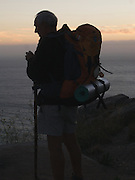 This pilgrim had arrived at Cape Finisterre just in time for sunset. He stood motionless in deep reflection watching over the sea.