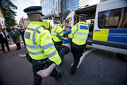 © Licensed to London News Pictures. 25/10/2021. London, UK. Insulate Britain climate change activist JOSHUA SMITH being arrested for blocking traffic on Bishopsgate in the City of London. The group have restarted their actions to block motorways and major roads causing disruption in the week before the COP26 climate meeting in Glasgow on 31/10/2021. Photo credit: Ben Cawthra/LNP