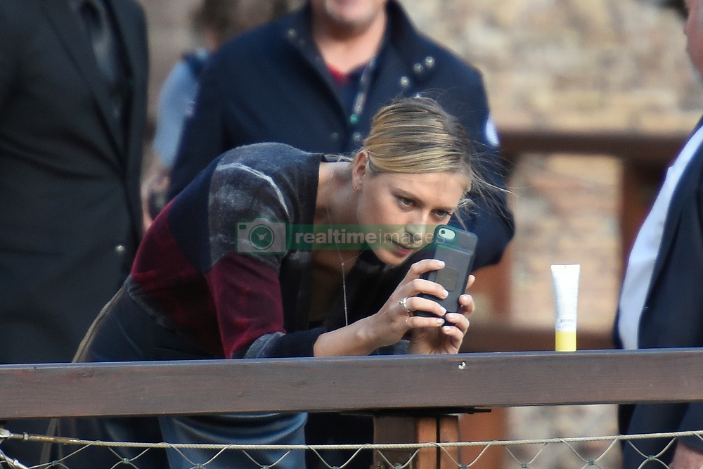 EXCLUSIVE PHOTOS Tennis star Maria Sharapova is seen photographing a tube of Supergoop sunscreen lip lotion with her mobile phone during an exhibition into the Coliseum in Rome. 14 May 2017 Pictured: Maria Sharapova. Photo credit: AM1999 / MEGA TheMegaAgency.com +1 888 505 6342