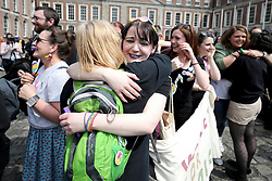 Members of the quartet Voices For Appeal embrace, as they wait at Dublin Castle for the result of the referendum on the 8th Amendment of the Irish Constitution which prohibits abortions unless a mother's life is in danger.