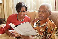NELSON ROLIHLAHLA MANDELA (July 18, 1918 - December 5, 2013), 95, world renown civil rights activist. Emerged from prison, to become the first black President of South Africa in 1994. Won 1993 Nobel Peace Prize. PICTURED: June 21, 2011 - Johannesburg, South Africa - U.S. First Lady MICHELLE OBAMA (L) and MANDELA (R) at his home, with his newest book titled 'Nelson Mandela by himself'. (Credit Image: © Nelson Mandela Foundation/ZUMAPRESS.com)