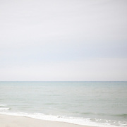 A man walks down an empty beach in Myrtle Beach in January.