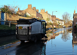 © Licensed to London News Pictures. 29/12/15<br /> York, UK. <br /> <br /> Council workers begin the clean up as flood water begins to subside on Huntington Road in York. Further rainfall is expected over coming days as Storm Frank approaches the east coast of the country.<br /> <br /> Photo credit : Ian Forsyth/LNP