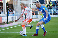 Blackpool midfielder Callum Guy  (25) sees this one out in front of Peterborough United midfielder Marcus Maddison (21)  during the EFL Sky Bet League 1 match between Peterborough United and Blackpool at The Abax Stadium, Peterborough, England on 29 September 2018.