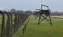 Guard towers and barbed wire fences at the Auschwitz-Birkenau Nazi concentration camps in Auschwitz, Poland on September 3, 2017. Auschwitz concentration camp was a network of German Nazi concentration camps and extermination camps built and operated by the Third Reich in Polish areas annexed by Nazi Germany during WWII. It consisted of Auschwitz I (the original camp), Auschwitz II–Birkenau (a combination concentration/extermination camp), Auschwitz II–Monowitz (a labor camp to staff an IG Farben factory), and 45 satellite camps. In September 1941, Auschwitz II–Birkenau went on to become a major site of the Nazi Final Solution to the Jewish Question. From early 1942 until late 1944, transport trains delivered Jews to the camp's gas chambers from all over German-occupied Europe, where they were killed en masse with the pesticide Zyklon B. An estimated 1.3 million people were sent to the camp, of whom at least 1.1million died. Around 90 percent of those killed were Jewish; approximately 1 in 6 Jews killed in the Holocaust died at the camp. Others deported to Auschwitz included 150,000 Poles, 23,000 Romani and Sinti, 15,000 Soviet prisoners of war, 400 Jehovah's Witnesses, and tens of thousands of others of diverse nationalities, including an unknown number of homosexuals. Many of those not killed in the gas chambers died of starvation, forced labor, infectious diseases, individual executions, and medical experiments. In 1947, Poland founded a museum on the site of Auschwitz I and II, and in 1979, it was named a UNESCO World Heritage Site. Photo by Somer/ABACAPRESS.COM