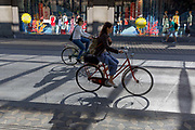 Women cyclists ride along Slovenska Cesta Street in the Slovenian capital, Ljubljana, on 26th June 2018, in Ljubljana, Slovenia. Ljubljana is a small city with flat terrain and a good cycling infrastructure. It was featured at eighth on the Copenhagenize index listing the most bike-friendly cities in the world.