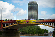 Amnesty Internationl activists unfurl banners from Vauxhall Bridge on 3rd June 2019 in London,United Kingdom. President Donald Trumps three day state visit begins today.