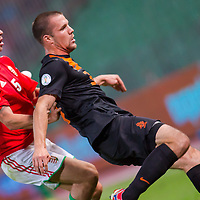 Hungary's Tamas Priskin (L) and Netherlands' Ron Vlaarhun (R) fight for the ball during a World Cup 2014 qualifying soccer match Hungary playing against Netherlands in Budapest, Hungary on September 11, 2012. ATTILA VOLGYI