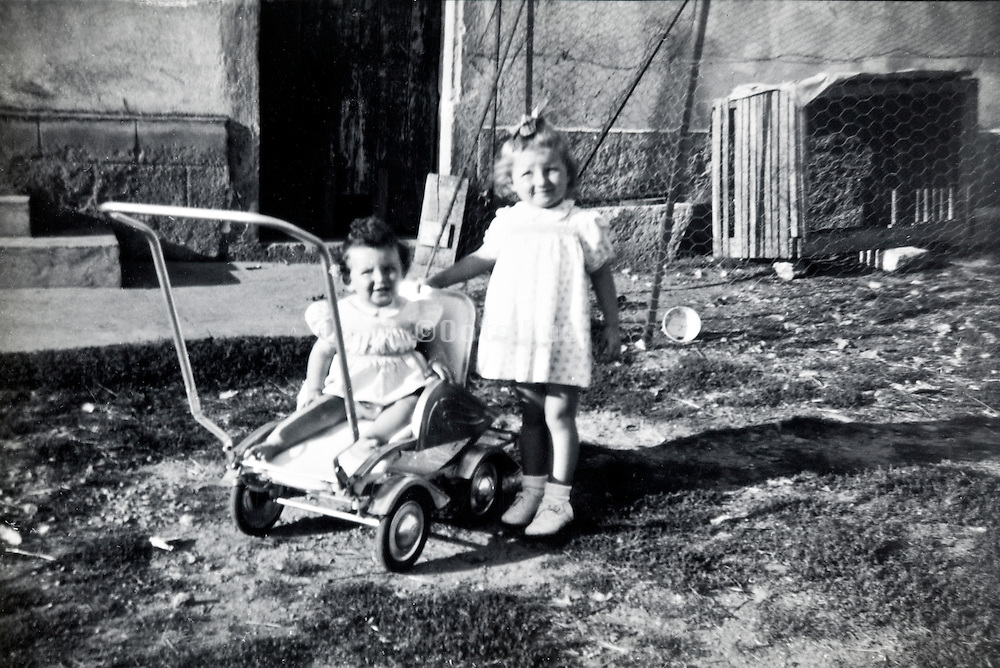 two little girls posing for a picture France 1900s
