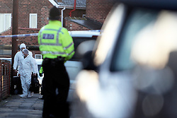 © Licensed to London News Pictures. 02/12/2011. Peterlee, UK. Police and Forensics at the scene where Four people have been found dead at a house in Peterlee, County Durham on January 2nd, 2011. The bodies of a man and three females were discovered after what police suspect was a firearms incident. Photo credit : Dave Charnley/LNP