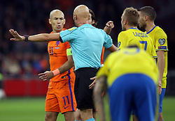 (l-r) Arjen Robben of Holland, referee Sergei Karasev during the FIFA World Cup 2018 qualifying match between The Netherlands and Sweden at the Amsterdam Arena on October 10, 2017 in Amsterdam, The Netherlands