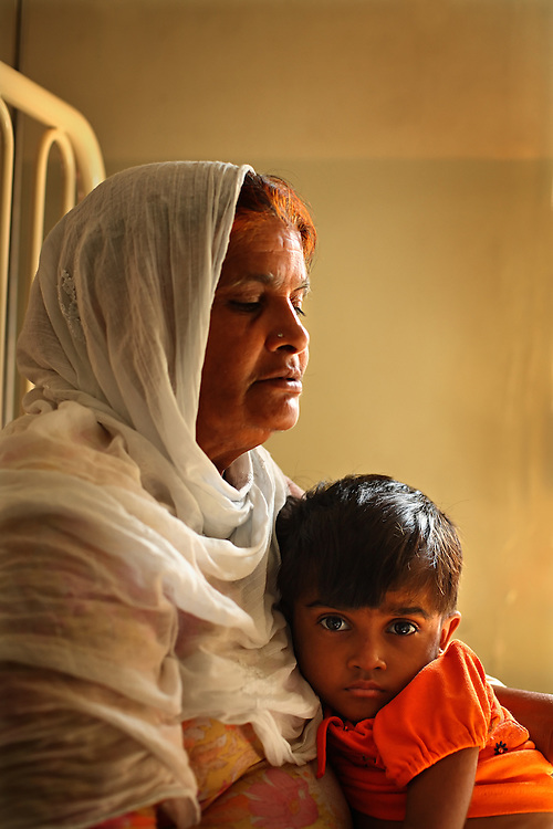 Zarina Bibi holds her granddaughter, Parwesha Bibi, 4, who is being treated for stomach pain inside the Children's Hospital at the Pakistan Institute of Medical Sciences, P.I.M.S., in Islamabad, Pakistan on Sept. 18, 2007.