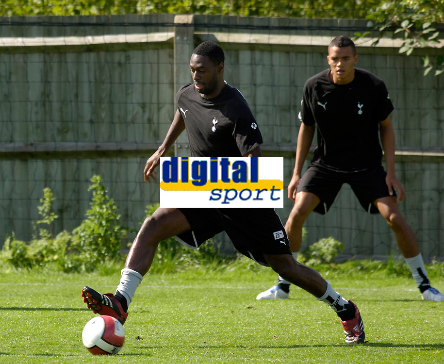 Photo: Daniel Hambury.<br />Tottenham Hotspur training session. 07/09/2006.<br />Spurs captain Ledley King (L) pictured during training. He is due to return to the first team after a long injury lay off.