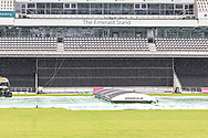 View of the Emerald stand and covers as rain falls before the the Vitality T20 Blast North Group match between Yorkshire Vikings and Leicestershire Foxes at Emerald Headingley Stadium, Leeds, United Kingdom on 2 September 2020.
