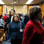Lynda de la Viña, center, exits the courtroom during a break in Feit's trial. De la Viña became an advocate for her cousin Irene Garza over the years, becoming the family spokesperson as they searched for a way to bring the case to trial. Each day of the trial, family members, lawyers, media and other onlookers packed the courtroom. Nathan Lambrecht/The Monitor