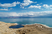 Aerial Photography with a drone. Elevated view of sink holes on the shore of the Dead Sea, Israel. The sink holes are caused by the rapidly receding water level (Approx. 5 cm per month)