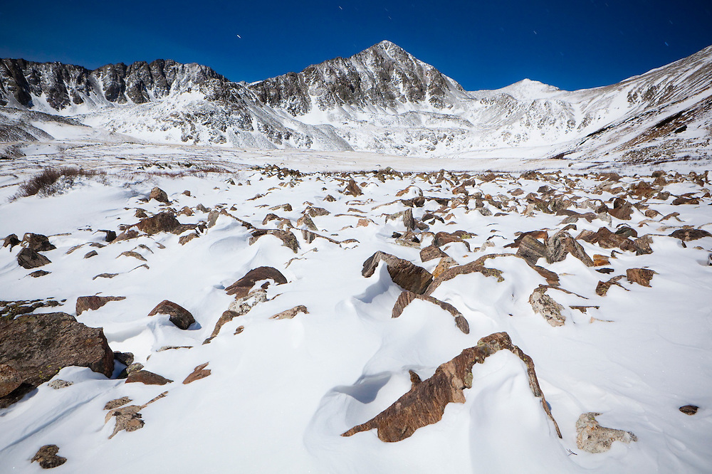 Lower Crystal Lake and Crystal Peak moonlit at night in the Tenmile Range, Arapaho National Forest, Colorado.