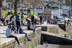 """© Licensed to London News Pictures. 29/03/2021. London, UK. Members of the public enjoy the sunshine in Richmond, South West London as weather forecasters predict highs of 23c in London and the South East this week as the """"Rule of Six"""" is reintroduced and marking the end of the """"Stay at Home"""" government advice. From today, Monday 29 March, two households or six people will be allowed to meet up. Playing golf, tennis and organised outdoor sports will also be allowed as England starts to unlock after a year of Covid-19 restrictions. Photo credit: Alex Lentati/LNP"""