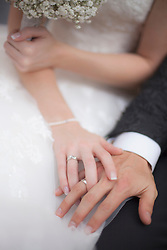 Mid section view of a bride and groom showing their wedding ring, Ammersee, Upper Bavaria, Bavaria, Germany