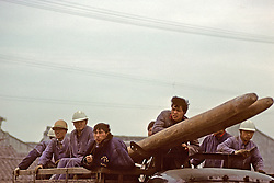 Construction Workers On Truck