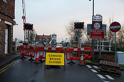 © Licensed to London News Pictures. 28/12/2015. Cawood, UK. Sandbags next to the the bridge on the river Ouse at Cawood in North Yorkshire which is closed due to flood water and rising tides. Several warnings of risk to life are sill in place in parts of Lancashire and Yorkshire where rainfall has been unusually high, causing heavy flooding. Photo credit: Ben Cawthra/LNP